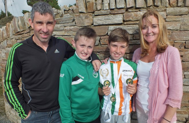 Three time Irish Champion, Adam McGeever pictured with his dad,  Con, mum, Leigh and brother, Joey.  Photo: Tommy Curran