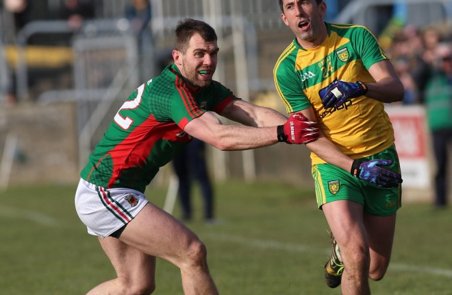 Rory Kavanagh under pressure from Seamus O'Shea