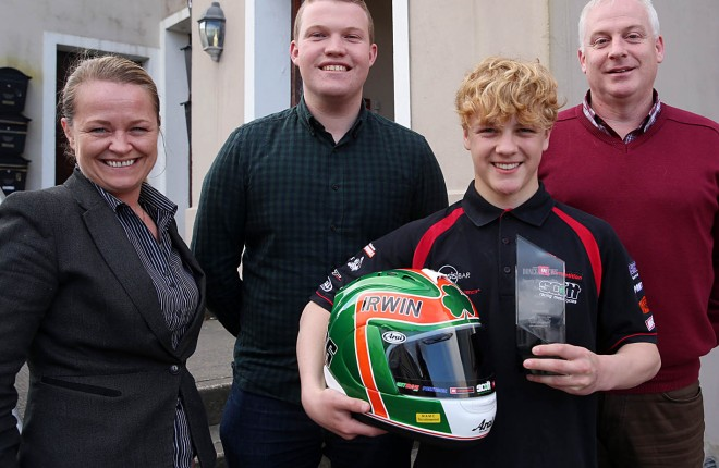 Rhys Irwin collects the Sports Personality of the Month award for March from Doreen Gallagher, Ryan Ferry, and Harry Walsh of the Donegal News. Photo: Declan Doherty.