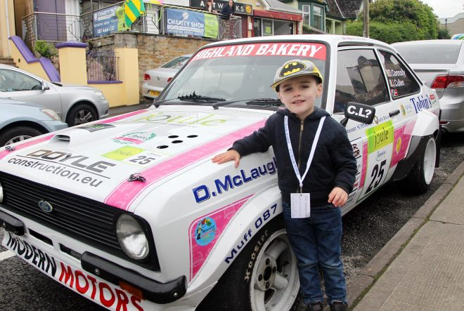 Logan O'Connor, pictured with James Cullen's car at the start of the rally.