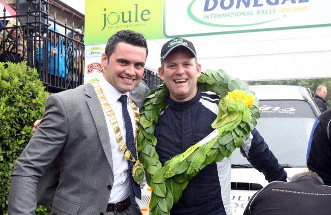 Cllr James Pat McDaid, Letterkenny Town Mayor congratulates fellow Glenswilly man, Rally champion Manus Kelly. Photo: Donna El Assaad