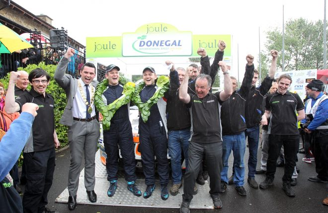 Joule Donegal International Rally 2016 champions Manus Kelly and Donall Barrett celebrate at the finish ramp with their team.