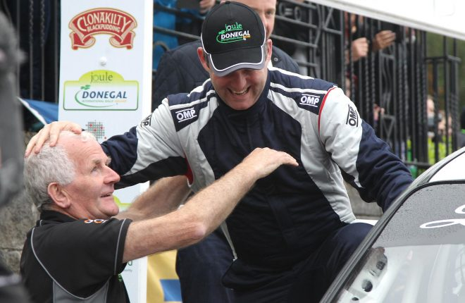 Happy Father's Day as Donal Kelly congratulates his son Manus at the finish ramp.