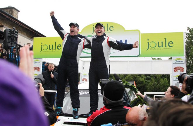 Elation at the ramp for local men Manus Kelly and Donall Barrett after they won the Joule Donegal International Rally by a fraction of a second. Photo: Donna El Assaad