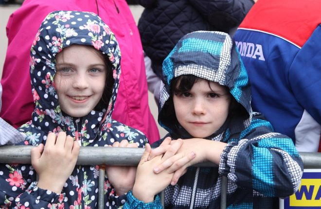 The wet weather didn't dampen the spirits of these two young rally fans on Sunday afternoon.