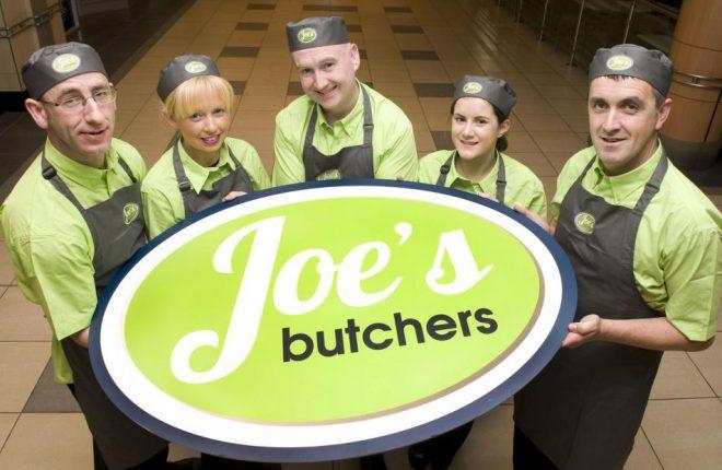 Joe McGee (centre) and staff.