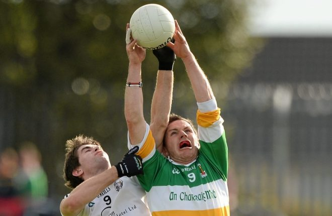 Former Tyrone star Conor Gormley claiming a high ball while playing for his club Carrickmore.