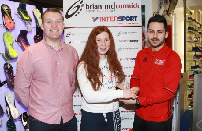 Seanóg Foody (Right), Brian McCormick Sports, and Ryan Ferry, Donegal News present the November Sports Personality of the Month Award to Grainne Russell.