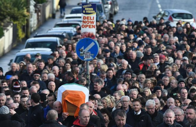 The remains of Former Deputy First Minister Martin McGuinness is carried by friends colleagues and relatives through the streets of the Bogside on Thursday afternoon.