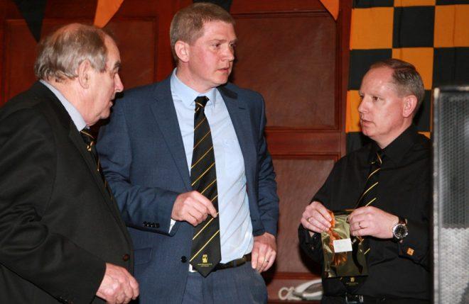 Cathal Greene, Ciaran Haran and Paul McGovern organising the draw.